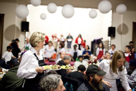 Guests being served during the All Saints' Cafe